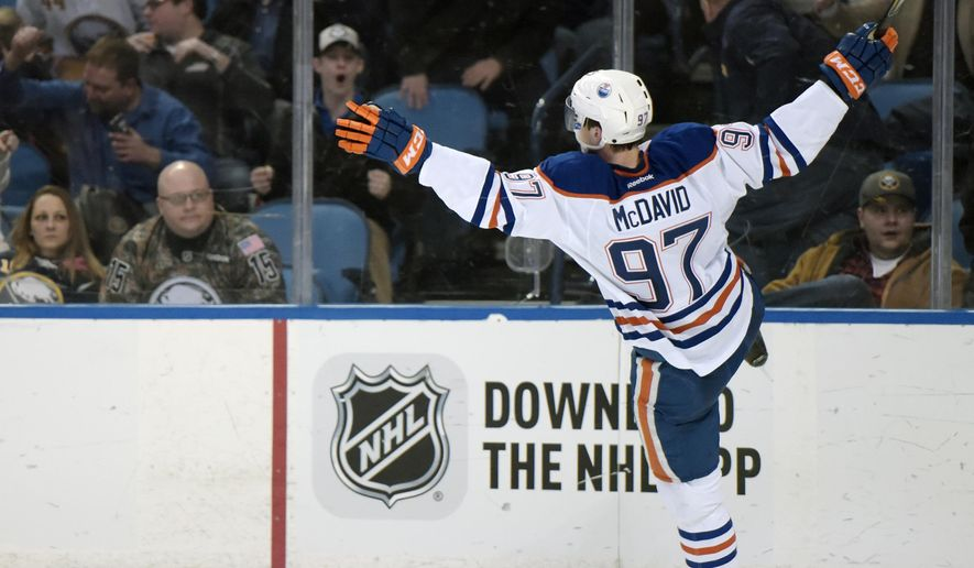 Edmonton Oilers center Connor McDavid celebrates his overtime goal against the Buffalo Sabres in an NHL hockey game Tuesday, March 1, 2016, in Buffalo, N.Y.  Edmonton won 2-1. (AP Photo/Gary Wiepert)