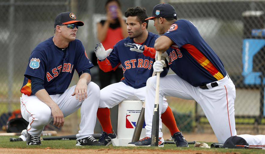 FILE - In this Feb. 23, 2016, file photo, Houston Astros manager A.J. Hinch, left, and Astros' Jose Altuve and Carlos Correa chat during a workout at the Astros spring training camp in Kissimmee, Fla. Altuve is one of only a handful of remaining Astros who endured the team's rebuilding project. (Karen Warren/Houston Chronicle via AP, File) MANDATORY CREDIT