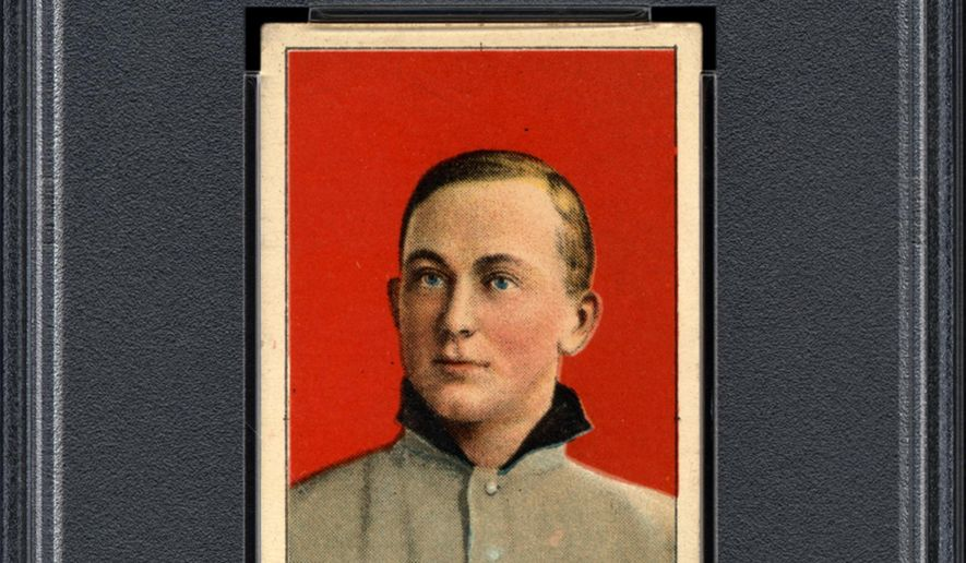 This undated photo provided by Professional Sports Authenticator shows one of seven Ty Cobb baseball cards, a baseball-card find of a lifetime, that were found crumpled paper bag in a dilapidated house. (Professional Sports Authenticator via AP)