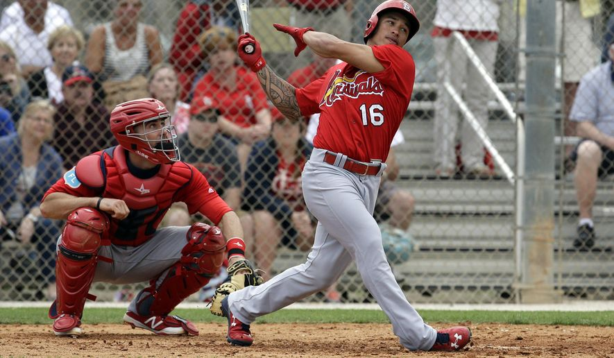 FILE - In this Feb. 29, 2016, file photo, St. Louis Cardinals' Kolten Wong swings during spring training intrasquad baseball game, in Jupiter, Fla. Making a long-term commitment to Kolten Wong as their second baseman, the St. Louis Cardinals agreed Wednesday, March 2, 2016, to a $25.5 million, five-year contract with the 25-year-old. (AP Photo/Jeff Roberson, File)