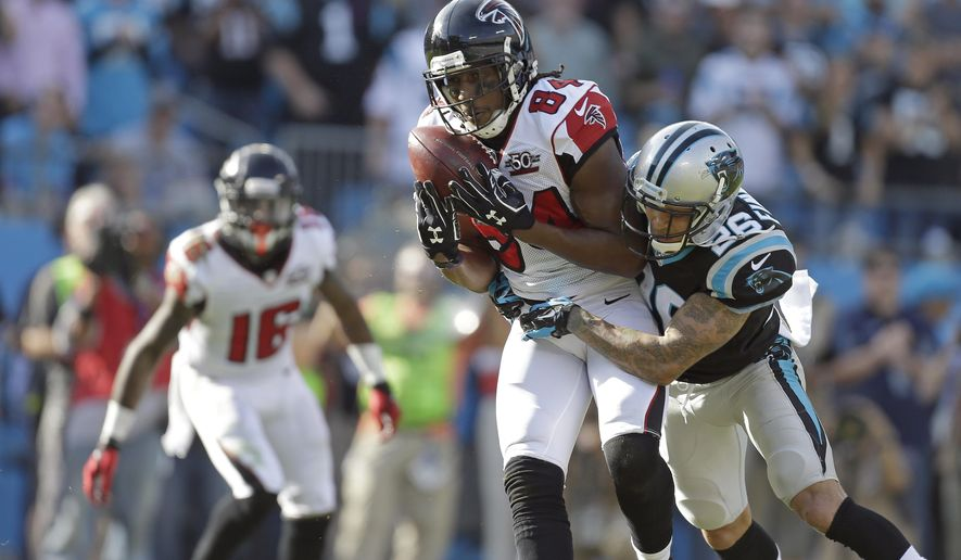 FILE - In this  Sunday, Dec. 13, 2015 file photo, Atlanta Falcons' Roddy White (84) makes a catch as Carolina Panthers' Cortland Finnegan (26) makes the hit during the first half of an NFL football game in Charlotte, N.C.  The Atlanta Falcons have released Roddy White, who holds the franchise career records for most catches, receiving yards and touchdown catches, Wednesday, March 2, 2016. (AP Photo/Bob Leverone, File)