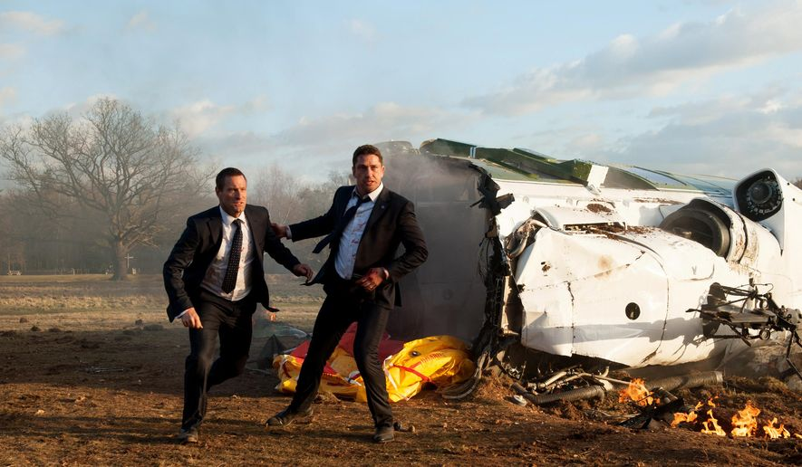 """This image released by Focus Features shows Aaron Eckhart, left, and Gerard Butler in a scene from Grammercy Pictures', """"London Has Fallen."""" (David Appleby/Grammercy Pictures/Focus Features via AP)"""