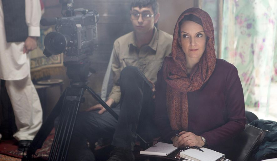 "In this image released by Paramount Pictures, Nicholas Braun portrays Tall Brian, left, and Tina Fey portrays Kim Baker in a scene from ""Whiskey Tango Foxtrot."" (Frank Masi/Paramount Pictures and Broadway Video/Little Stranger Productions via AP)"