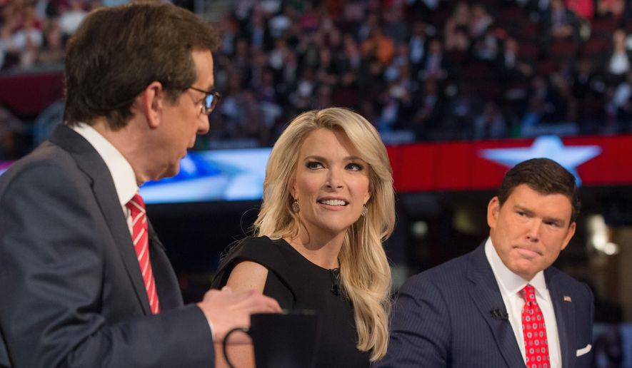 FOX News moderators Megyn Kelly, center, and Bret Baier, right, listens as Chris Wallace, left, beings introductions during the first Republican presidential debate in Cleveland, in this Aug. 6, 2015, file photo. (AP Photo/John Minchillo, File)