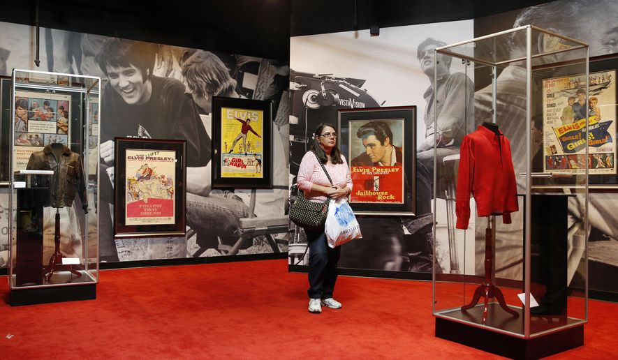 "FILE - In this April 23, 2015 file photo, a woman tours an Elvis exhibition on the first day of ""Graceland Presents Elvis: The Exhibition - The Show - The Experience"" at the Westgate Las Vegas hotel in Las Vegas. The Elvis Presley exhibit that opened with great fanfare last year has abruptly closed amid a leasing dispute that involves hundreds of the King's artifacts. The Westgate Las Vegas Resort and Casino said it's holding the valuables from its Elvis attraction because the operators, Exhibit A Circle LLC, have defaulted in its 10-year contract with the off-Strip property. (AP Photo/John Locher, File)"