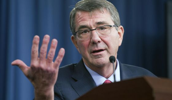 In this Jan. 28, 2016 file photo, Defense Secretary Ash Carter gestures during a news conference at the Pentagon. (AP Photo/Cliff Owen, File)