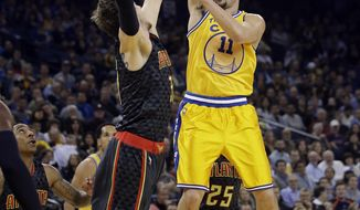 Golden State Warriors' Klay Thompson (11) shoots against the Atlanta Hawks during the first half of an NBA basketball game Tuesday, March 1, 2016, in Oakland, Calif. (AP Photo/Marcio Jose Sanchez)