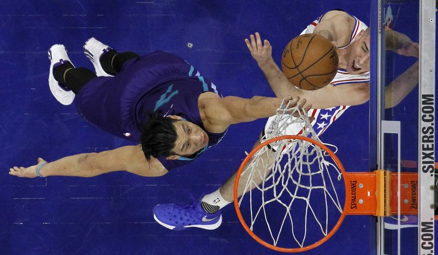 Philadelphia 76ers' T.J. McConnell, right, tries to get a shot past Charlotte Hornets' Jeremy Lin during the first half of an NBA basketball game, Wednesday, March 2, 2016, in Philadelphia. (AP Photo/Matt Slocum)