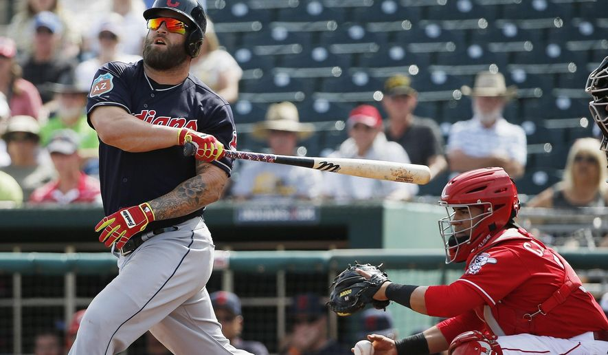 Cleveland Indians' Mike Napoli, left, loses control of his bat as his misses on a swing as Cincinnati Reds catcher Ramon Cabrera, right, holds onto the ball during the first inning of a Cactus League baseball game Wednesday, March 2, 2016, in Goodyear, Ariz. (AP Photo/Ross D. Franklin)