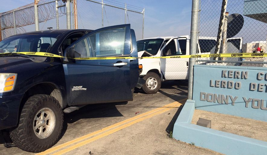 This image provided by Ray Pruitt with the Kern County Sheriffs Office shows a pickup truck after a white prison van crashed into it at the gates of the Lerdo Pre-Trial Facility near Bakersfield, Calif., on Wednesday, March 2, 2016. The California Highway Patrol says an inmate crashed the van into a gate during an escape attempt at a Southern California jail. California Highway Patrol Officer Robert Rodriguez says seven inmates were in the van when one of them managed to get into the driver's seat early Wednesday at the Lerdo Pre-Trial Facility outside Bakersfield. (Ray Pruitt/Kern County Sheriffs via AP)