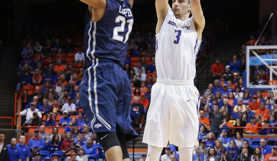 Boise State's Anthony Drmic (3) shoots over Nevada's Eric Cooper Jr (21) during the first half of an NCAA college basketball game in Boise, Idaho, on Wednesday, March 2, 2016. (AP Photo/Otto Kitsinger)