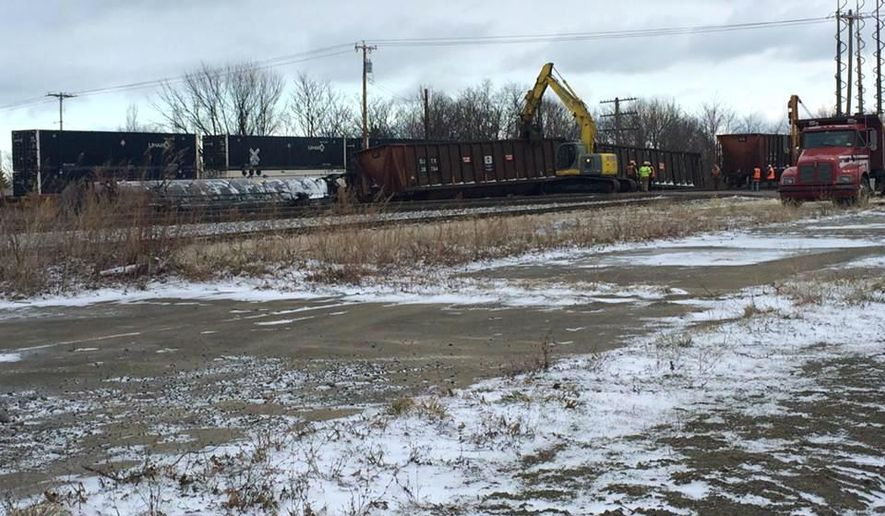 Crews work to clear the site of a 16-car Norfolk Southern freight train derailment that forced the evacuation of dozens of western New York homes after ethanol leaked from two tankers, Wednesday, March 2, 2016, in Ripley, N.Y. (Alice Waters/The Observer via AP) MANDATORY CREDIT