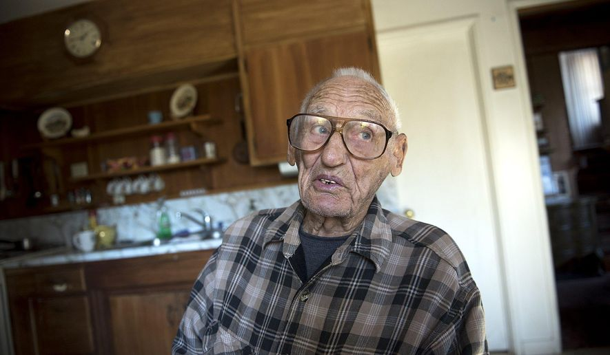 FILE - In this Thursday, Oct. 29, 2015 file photo, Delmer Berg, 99, speaks during an interview at his home in Columbia, Calif. Berg, the last known American survivor who fought fascists in 1930s Spain, died at his California home on Sunday, Feb. 28, 2016, Marina Garde from the Abraham Lincoln Brigade Archives in New York confirmed in a written statement. He was 100. Berg was among about 2,800 members of the Abraham Lincoln Brigade who sought to defend an elected government from a military rebellion led by Gen. Francisco Franco. The revolt was successful, and Franco led Spain for decades. (Andy Alfaro/Modesto Bee via AP, File)
