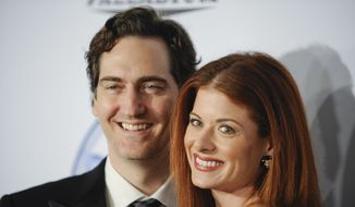 FILE - In this Jan. 24, 2009 file photo, producer Daniel Zelman and actress Debra Messing, right, arrive at the 20th Annual Producers Guild Awards in Los Angeles. (AP Photo/Gus Ruelas, File)