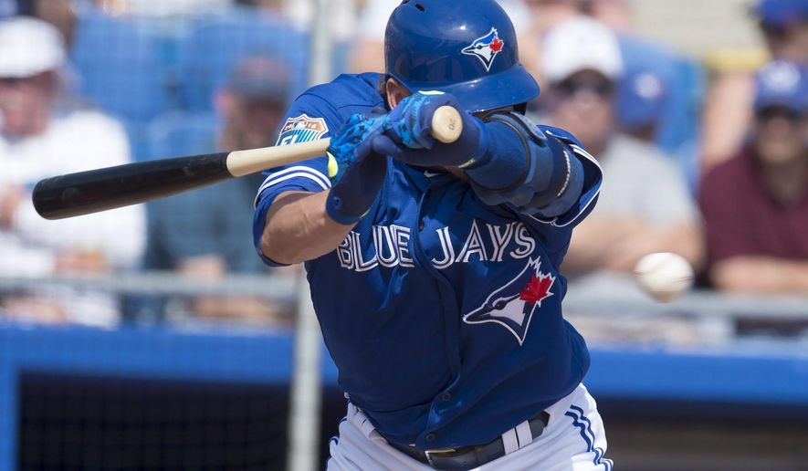 Toronto Blue Jays' Josh Donaldson is hit by a pitch during the fourth inning of a spring training baseball game against the Philadelphia Phillies in Dunedin, Fla., Wednesday March 2, 2016. (Frank Gunn/The Canadian Press via AP) MANDATORY CREDIT