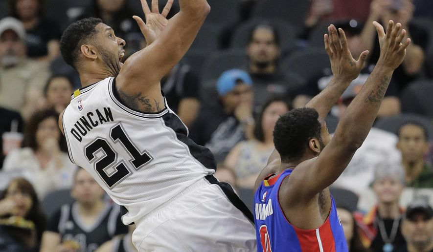 San Antonio Spurs center Tim Duncan (21) shoots over Detroit Pistons center Andre Drummond (0) during the first half of an NBA basketball game, Wednesday, March 2, 2016, in San Antonio. (AP Photo/Eric Gay)