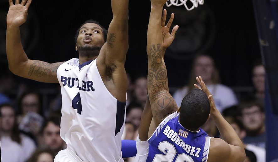 Butler forward Tyler Wideman (4) blocks the shot by Seton Hall forward Desi Rodriguez (20) during the first half of an NCAA college basketball game, Wednesday, March 2, 2016 in Indianapolis. (Matt Kryger/The Indianapolis Star via AP)  NO SALES; MANDATORY CREDIT