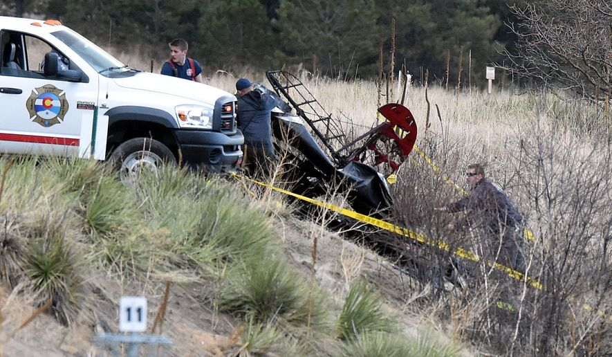 First responders put down a tarp over a small plane that crashed near Palmer Lake, Colo.,  on Wednesday, March 2, 2016. The crash happened Wednesday morning near Palmer Lake but no other details have been released. The town is near the Air Force Academy but the school told The Gazette of Colorado Springs that the plane isn't one of its aircraft.  (Jerilee Bennett/The Gazette via AP) MAGS OUT; MANDATORY CREDIT