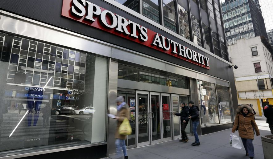 People enter a Sports Authority store, in New York, Wednesday, March 2, 2016. Sports Authority is filing for Chapter 11 bankruptcy protection. The Englewood, Colo., company has 463 stores in 41 states and Puerto Rico. (AP Photo/Richard Drew)