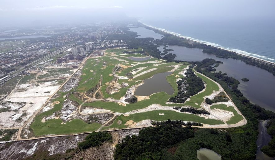 FILE - This Oct. 9, 2015, aerial file photo, shows the Olympic Golf Course in Rio de Janeiro. The 2016 Olympic Games will be held in Rio de Janeiro. PGA Commissioner Tim Finchem had a free charter lined up for the best players in the world to jet down to Brazil, play 18, and head back home. The occasion was a test event for the new Olympic sport on a golf course built specifically for the games in August. The problem was, no one wanted to go. Instead, a few local players will try out the course next week to make sure it is ready for golf's return to the Olympics for the first time in 112 years. (AP Photo/David J. Phillip, File