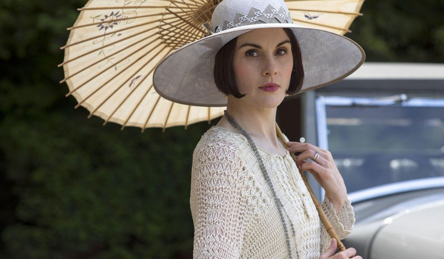 """This image released by PBS shows Michelle Dockery as Lady Mary in a scene from the final season of """"Downton Abbey."""" The series finale airs in the U.S. on Sunday. (Nick Briggs/Carnival Film & Television Limited 2015 for MASTERPIECE via AP)"""