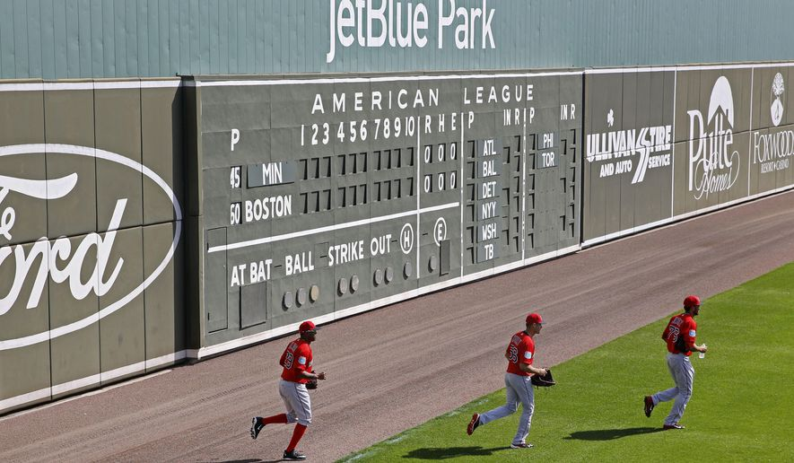 Boston Red Sox pitchers Roenis Elias, from left, Joe Kelly and Williams Jerez jog onto the field for a workout before a spring training baseball game against the Minnesota Twins in Fort Myers, Fla., Wednesday, March 2, 2016. (AP Photo/Patrick Semansky)