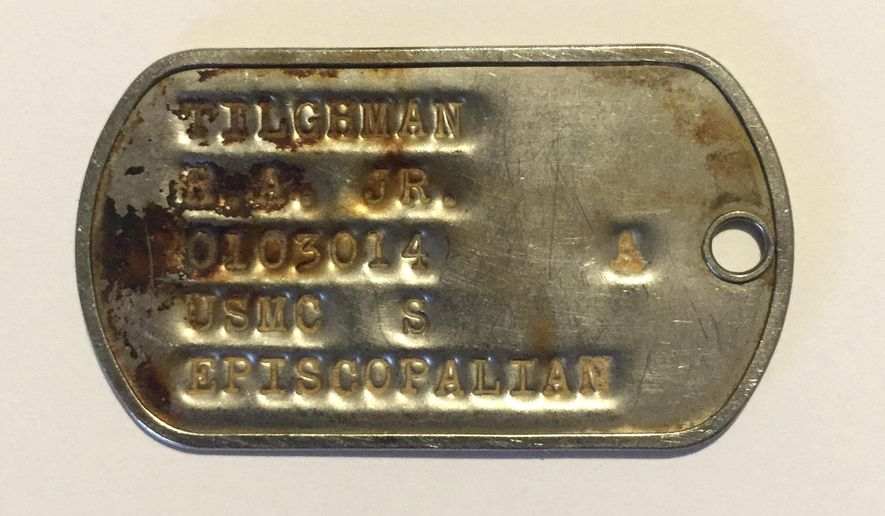 This 2015 photo provided by BNY Mellon shows a dog tag from the Vietnam War identifying U.S. Marine R. A. Tilghman, Jr. While vacationing in Vietnam in 2014, Charles Thompson purchased the tag from a local vendor thinking he could find and return it to its owner. After more than a year of research, he located Richard Tilghman, of New Canaan, Conn. (Charles Thompson/BNY Mellon via AP)
