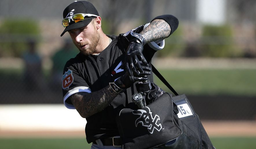 FILE - In this Feb. 26, 2016, file photo, Chicago White Sox's Brett Lawrie picks up his gear after taking batting practice during a spring training baseball workout, in Glendale, Ariz. The one-time top prospect with Toronto, now 26, is hoping to restart his career and bring his trademark energy to the South Side of Chicago. (AP Photo/Ross D. Franklin, File)