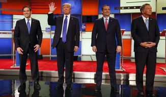 Republican presidential candidates Marco Rubio, Donald Trump, Ted Cruz and John Kasich take the stage before the Republican debate Thursday in Detroit. (Associated Press)