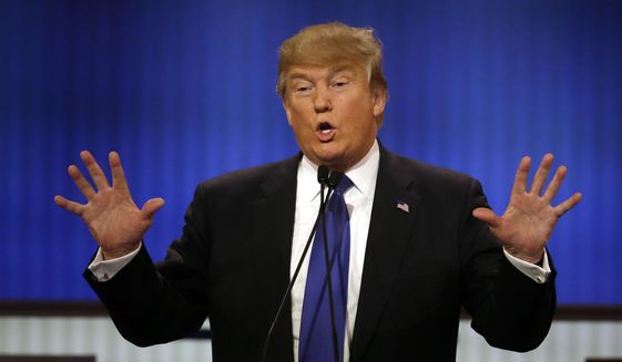 """Donald Trump said he doesn't like the innuendo that he might not be well-endowed. """"I guarantee you there's no problem, I guarantee you,"""" he said. (Associated Press)"""