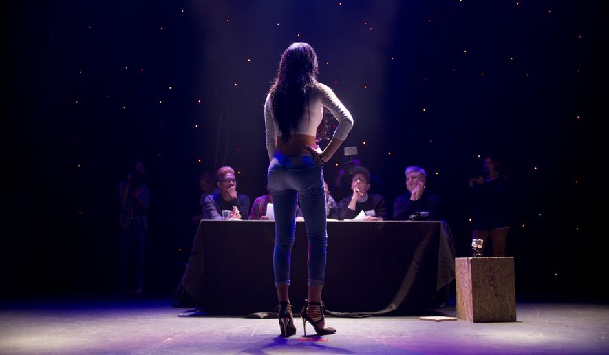 Arab Israeli contestant Tallinn Abu Hana poses for the judges during auditions for the first Miss Trans Israel beauty pageant in Tel Aviv, Israel, Thursday, March 3, 2016. The winner will represent Israel at a Miss Trans Star International pageant to be held in Spain in August. (AP Photo/Ariel Schalit)