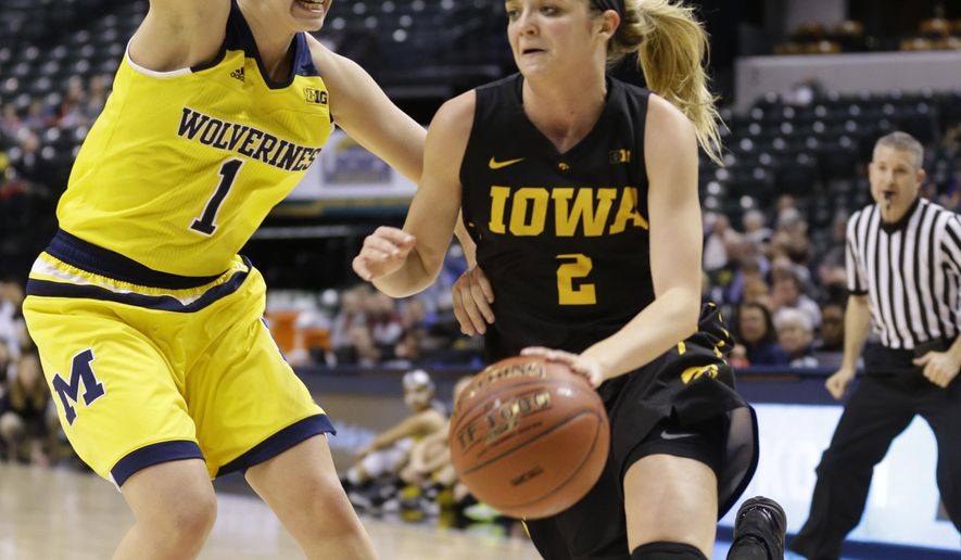 Iowa guard Ally Disterhoft (2) drives on Michigan guard Madison Ristovski (1) in the second half of an NCAA college basketball game at the Big Ten Conference tournament in Indianapolis, Thursday, March 3, 2016. Iowa defeated Michigan 97-85. (AP Photo/Michael Conroy)
