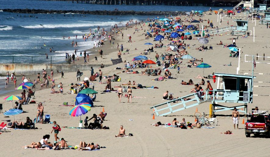 FILE - In this Feb. 15, 2016, file photo swimmers and sunbathers gather at Redondo Beach, Calif. El Nino has so far left much of drought-stricken California in the dust, delivering a few quick storms but not yet bringing the legendary rain previously linked to the periodic ocean-warming phenomenon. (AP Photo/John Antczak, File)