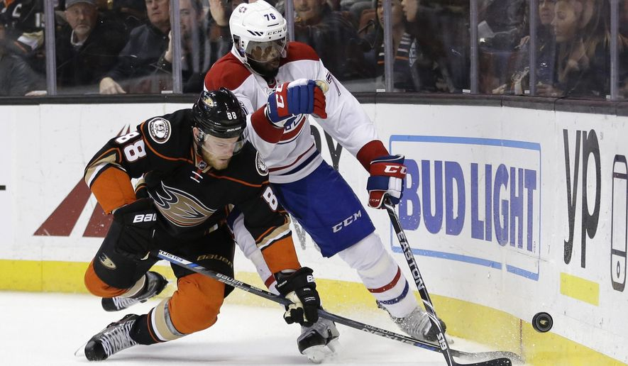 Anaheim Ducks' Jamie McGinn, left, and Montreal Canadiens' P.K. Subban fight for the puck during the second period of an NHL hockey game Wednesday, March 2, 2016, in Anaheim, Calif. (AP Photo/Jae C. Hong)