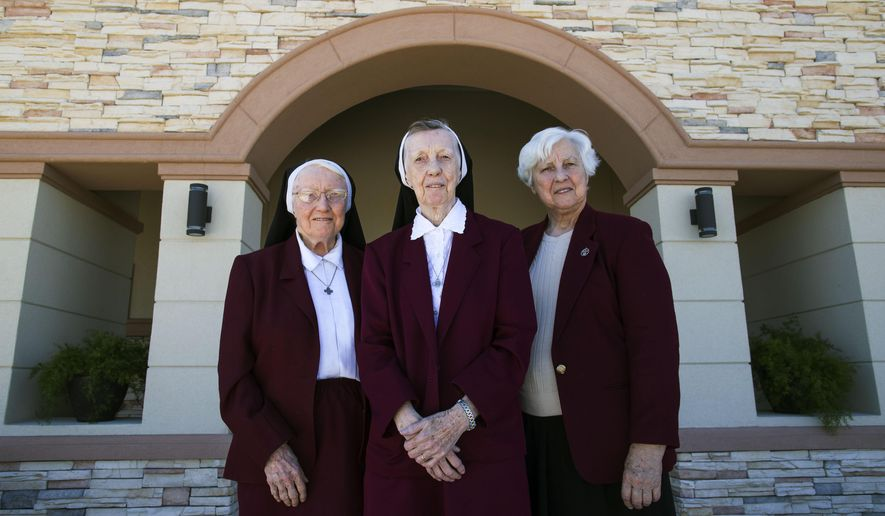 ADVANCE FOR WEEKEND EDITIONS MARCH 5-6 - In this Feb. 2016 photo, Sisters Catherine, Maria Elizabeth, and Colette Brehony pose together in front of the Sisters of the Incarnate Word and Blessed Sacrament convent on Lipes Boulevard in Corpus Christi, Texas.  (Courtney Sacco/Corpus Christi Caller-Times via AP) MANDATORY CREDIT; MAGS OUT; TV OUT
