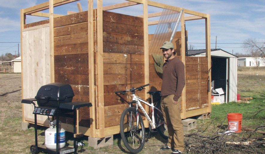 ADVANCE FOR WEEKEND EDITIONS - In this Monday, Jan. 25, 2015 photo, New Hampshire native Benjamin Garcia stands outside of the tiny house he is building in Spur, Texas. (Josie Musico/Lubbock Avalanche-Journal via AP) ALL LOCAL TELEVISION OUT; MANDATORY CREDIT