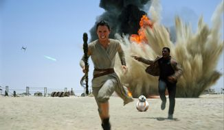 "This photo provided by Disney shows Daisey Ridley as Rey, left, and John Boyega as Finn, in a scene from the new film, ""Star Wars: The Force Awakens."" The film will be available for purchase on Digital HD beginning on April 1, and on Blu-ray and DVD on April 5.  (Disney/Lucasfilm via AP)"