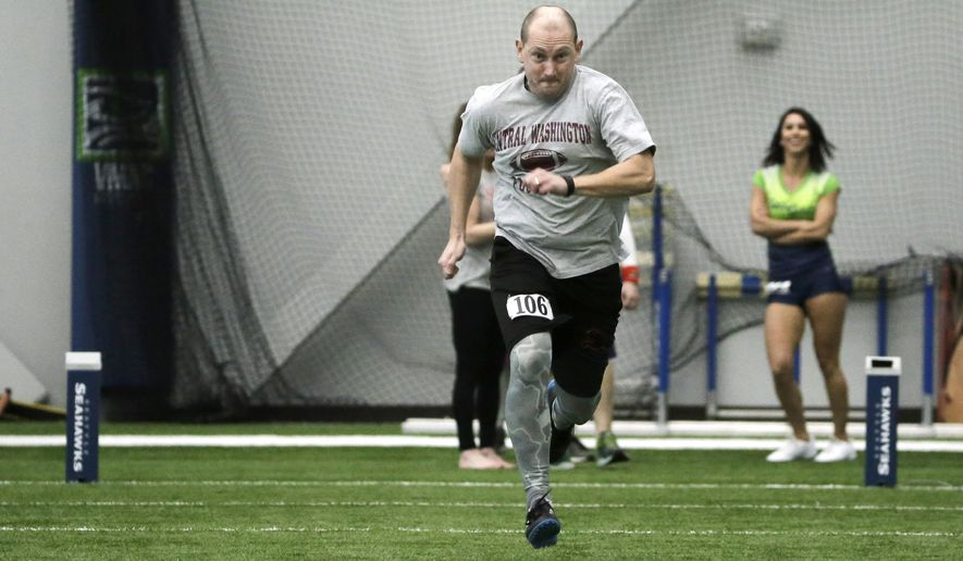 "In this photo taken Monday, Feb. 29, 2016, Associated Press sportswriter Tim Booth runs the 40-yard dash as he takes part in the Inaugural Seahawks.com Seattle Media Combine at the team's NFL football practice facility in Renton, Wash. Booth and other media representatives competed in the 40-yard dash, the vertical and broad jumps, the three-cone drill, the shuttle run and a football pass-catching drill called ""the gauntlet."" (AP Photo/Ted S. Warren)"