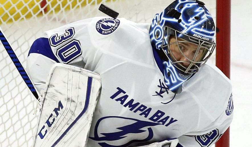 Tampa Bay Lighting goaltender Ben Bishop makes a shoulder save against the Ottawa Senators during the first period of an NHL hockey game Thursday, March 3, 2016, in Otttawa, Ontario. (Fred Chartrand/The Canadian Press via AP)