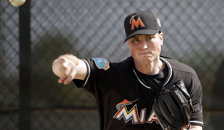 FILE - In this Feb. 22, 2016, file photo, Miami Marlins pitcher Carter Capps throws a bullpen session during spring training baseball practice in Jupiter, Fla. Capps is expected to be sidelined for an extended period because of discomfort in his right elbow, the team said Thursday, March 3, 2016. In addition, the right-hander has scheduled a visit Monday, March 7, with specialist Dr. James Andrews in Gulf Breeze, Florida, to determine whether he needs surgery. (AP Photo/Jeff Roberson, File)