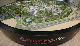 An architectural model view of the Dubai Parks and Resorts complex is displayed in Dubai, United Arab Emirates, Tuesday, March 1, 2016. This cross-cultural collage will be Dubai Parks & Resorts, a $2.8-billion-dollar bet on tourism in this Mideast city-state featuring a Taj Mahal-inspired theatre, the interlocking plastic bricks of Legoland and movie-themed attractions. (AP Photo/Kamran Jebreili)