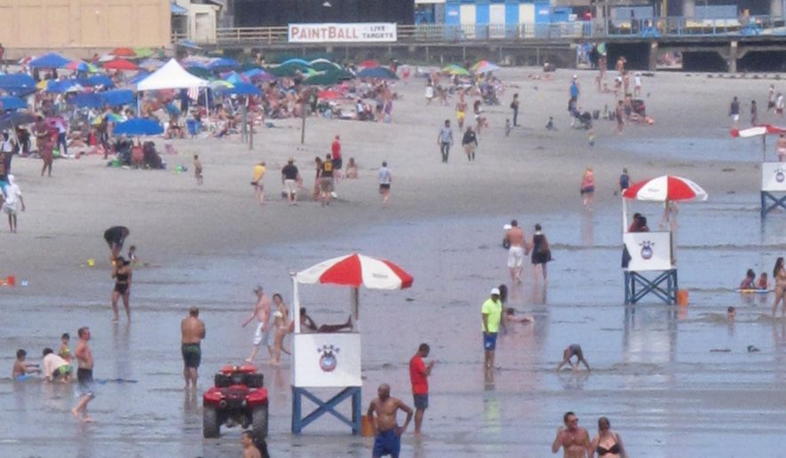 This July 3, 2015 photo shows tourists on the beach in Atlantic City, N.J. just before the Independence Day holiday. Figures released on Thursday March 3, 2016 showed that the tourism industry generated $43.4 billion in New Jersey in 2015, an increase of more than 3 percent. (AP Photo/Wayne Parry)