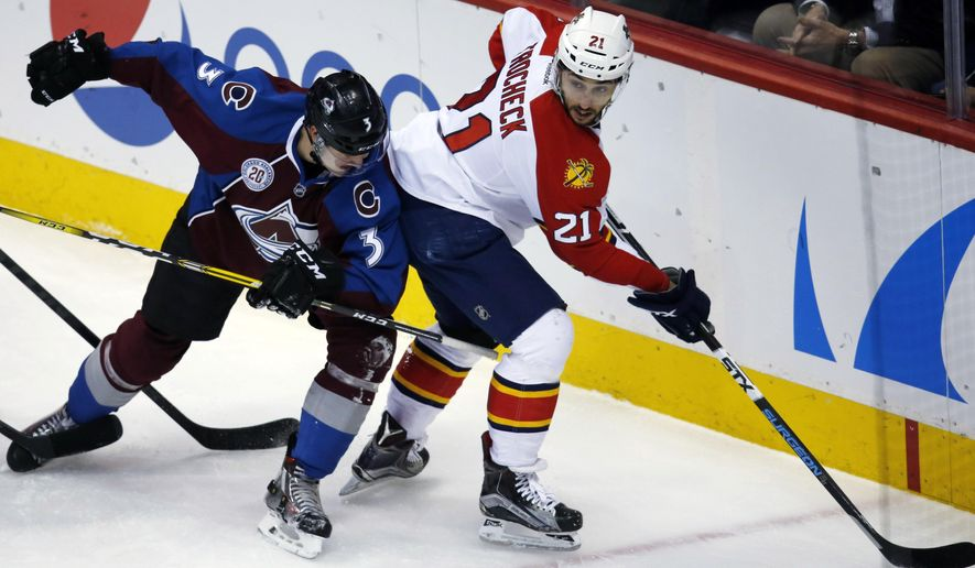 Colorado Avalanche defenseman Chris Bigras, left, ties up Florida Panthers center Vincent Trocheck who tries to center a pass in the first period of an NHL hockey game Thursday, March 3, 2016, in Denver. (AP Photo/David Zalubowski)