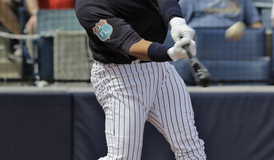 New York Yankees' Alex Rodriguez hits a two-run home run off Philadelphia Phillies starting pitcher Adam Morgan during the first inning of a spring training baseball game Thursday, March 3, 2016, in Tampa, Fla. Carlos Beltran also scored on the play. (AP Photo/Chris O'Meara)