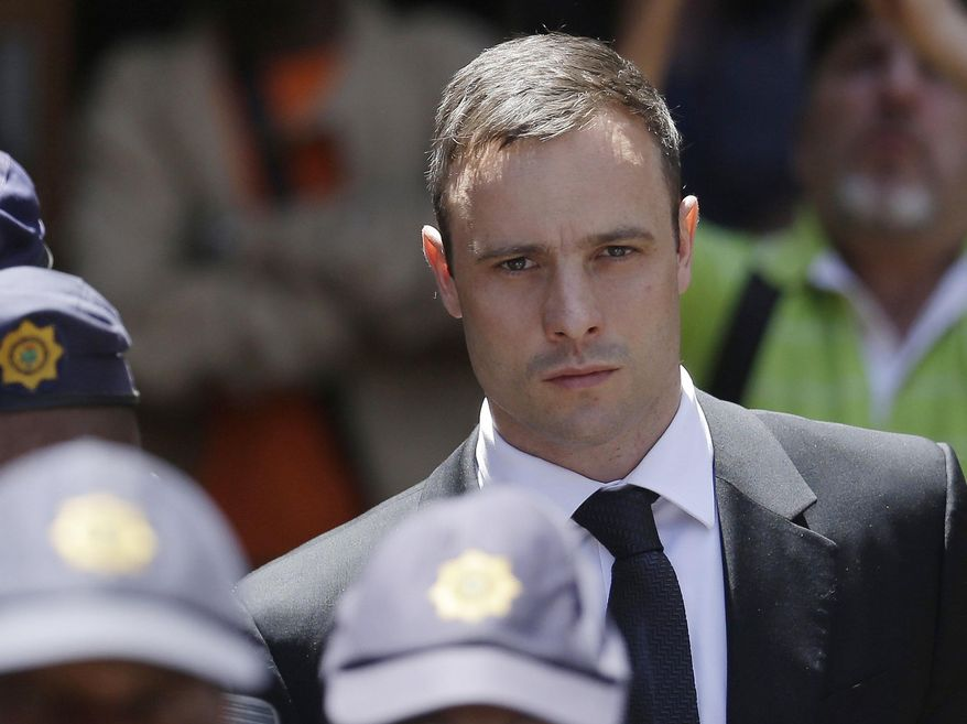 FILE - In this Friday, Oct. 17, 2014 file photo, Oscar Pistorius is escorted by police officers as he leaves the high court in Pretoria, South Africa. A lawyer for Oscar Pistorius says South Africa's highest court has dismissed the former track star's appeal of his murder conviction. The ruling by the Constitutional Court on Thursday March 3, 2016 clears the way for a judge to sentence Pistorius for murder at a hearing scheduled for April 18. (AP Photo/Themba Hadebe, File)