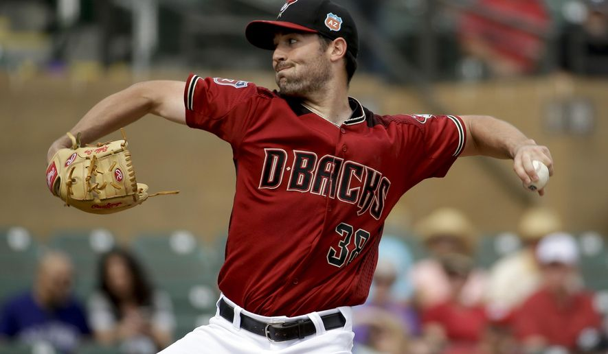 Arizona Diamondbacks starting pitcher Robbie Ray throws against the Colorado Rockies during the first inning of a spring baseball game in Scottsdale, Ariz., Thursday, March 3, 2016. (AP Photo/Chris Carlson)