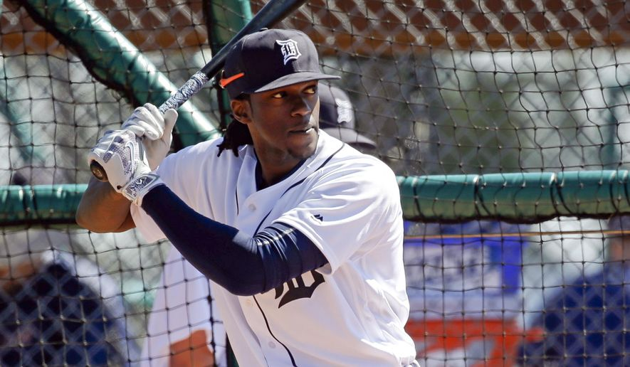 FILE - In this Feb. 27, 2016, file photo, Detroit Tigers' Cameron Maybin takes batting practice during a spring training baseball workout in Lakeland, Fla. Maybin is likely to miss the start of the season because of a broken left wrist. (AP Photo/John Raoux, File)