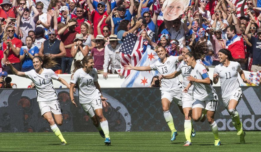 FILE - In this July 5, 2015 file photo, United States teammates, left to right, Morgan Brian (14), Tobin Heath (17), Alex Morgan (13), Lauren Holiday (12), Carli Lloyd (10) and Ali Krieger (11) celebrate after Lloyd's second goal against Japan during the first half of the FIFA Women's World Cup soccer championship in Vancouver, British Columbia, Canada. A federal judge in Chicago is set to make a high-stakes ruling to determine whether the world-champion U.S. women's soccer team has the right to strike before this year's Olympics. At the first status hearing in the case Thursday, March 3, 2016, a judge set May 25 for in-court arguments between the soccer federation and the players' union on the issue. (Jonathan Hayward/The Canadian Press via AP, File) MANDATORY CREDIT