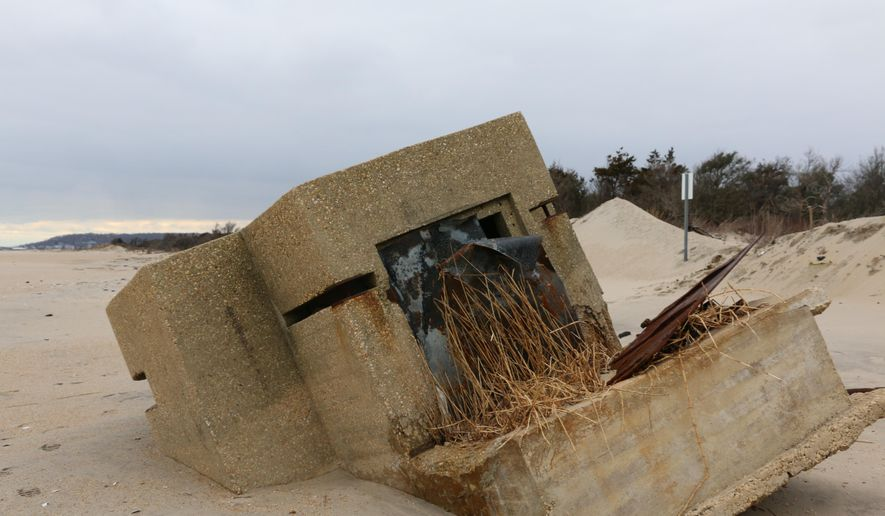 In this undated photo, a concrete sentry box that has stood on the beach at Sandy Hook is falling into the ocean in Sandy Hook, N.J. The military sentry boxes at Sandy Hook had been used during World War II to watch for enemy ships and submarines. (MaryAnn Spoto /NJ Advance Media via AP)  TV OUT; MAGS OUT; INTERNET OUT; NO SALES; NO ARCHIVING; MANDATORY CREDIT