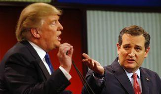 Republican presidential candidates, businessman Donald Trump and Sen. Ted Cruz, R-Texas, argue a point during a Republican presidential primary debate at Fox Theatre, Thursday, March 3, 2016, in Detroit. (AP Photo/Paul Sancya) ** FILE **